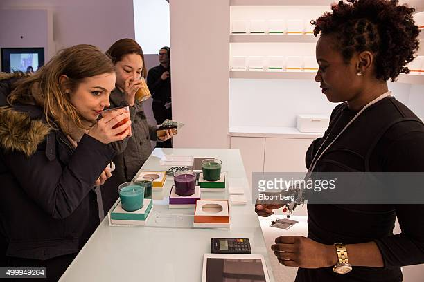 Visitors smell scented candles at the Museum of Feelings in New York US on Monday Nov 30 2015 The Museum of Feelings a three week pop up venue is a...