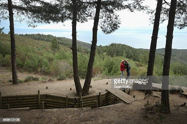 Visitors snap a selfie next to a recreated Turkish trench from the Gallipoli campaign at Chunuk Bair as the Aegean Sea lies behind on April 7, 2015...