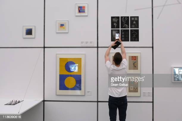 A visitors snaps a photo in the 'Corresponding With' portion at the 'Bauhaus Imaginista' exhibition at the Haus der Kulturen der Welt on March 17...