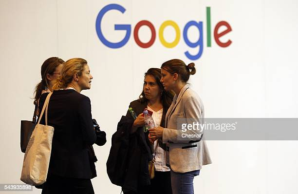 Visitors speak in front of a Google logo during the Viva Technology show on June 30 2016 in Paris France Viva Technology Startup Connect the new...