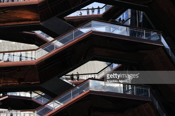 Visitors spend their time at 'The Vessel' a public art structure on the West Side of Midtown Manhattan in New York United States on March 18 2019 The...