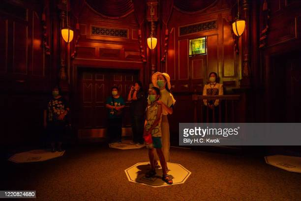 Visitors stand apart to enforce social distancing at Walt Disney Co's Disneyland Resort on June 18 2020 in Hong Kong China