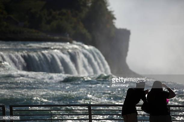 Visitors stand at Prospect Point next to the American Falls in Niagara Falls New York US on Thursday Sept 25 2014 The Niagara Falls State Park...