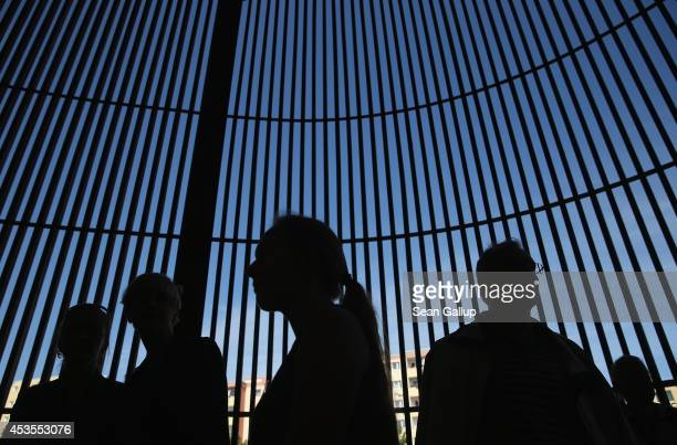 Visitors stand at the Chapel of Reconciliation, which stands at the site of the former Church of Reconciliation, demolished by east German...