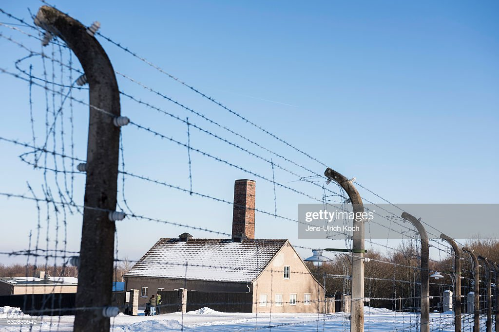 Visitors stand at the crematory of the Buchenwald concentration camp memorial on January 27, 2017 near Weimar, Germany.