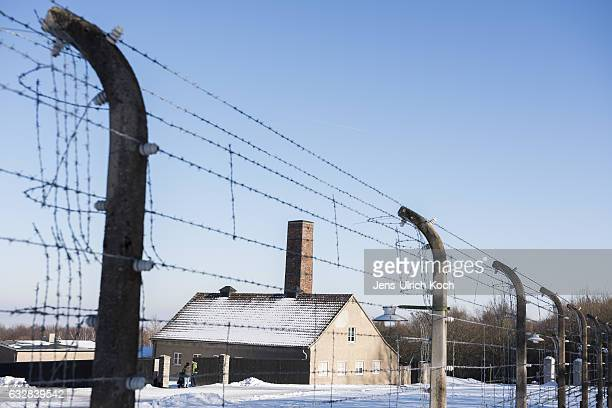 Visitors stand at the crematory of the Buchenwald concentration camp memorial on January 27 2017 near Weimar Germany