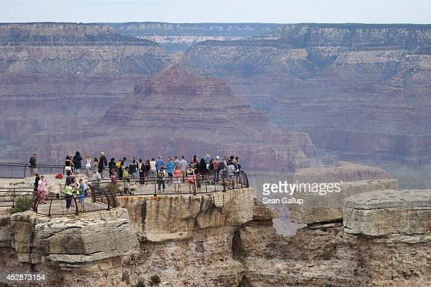 Visitors stand at the Grand Canyon South Rim on July 14 2014 at Grand Canyon National Park Arizona The Grand Canyon is among the state's biggest...