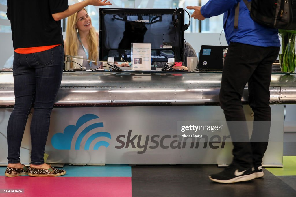 Visitors stand at the reception desk of Skyscanner Ltd.'s headquarters in Edinburgh, U.K., on Tuesday, Feb. 7, 2017. More coders are choosing to live in Edinburgh over London, according to a report by developer community Stack Overflow, reported the Scotsman in Dec. 2017. Photographer: Chris Ratcliffe/Bloomberg via Getty Images