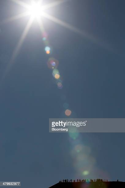 Visitors stand at the top of the Pyramid of the Sun during celebrations for the Spring Equinox at the archaeological site of Teotihuacan Mexico on...