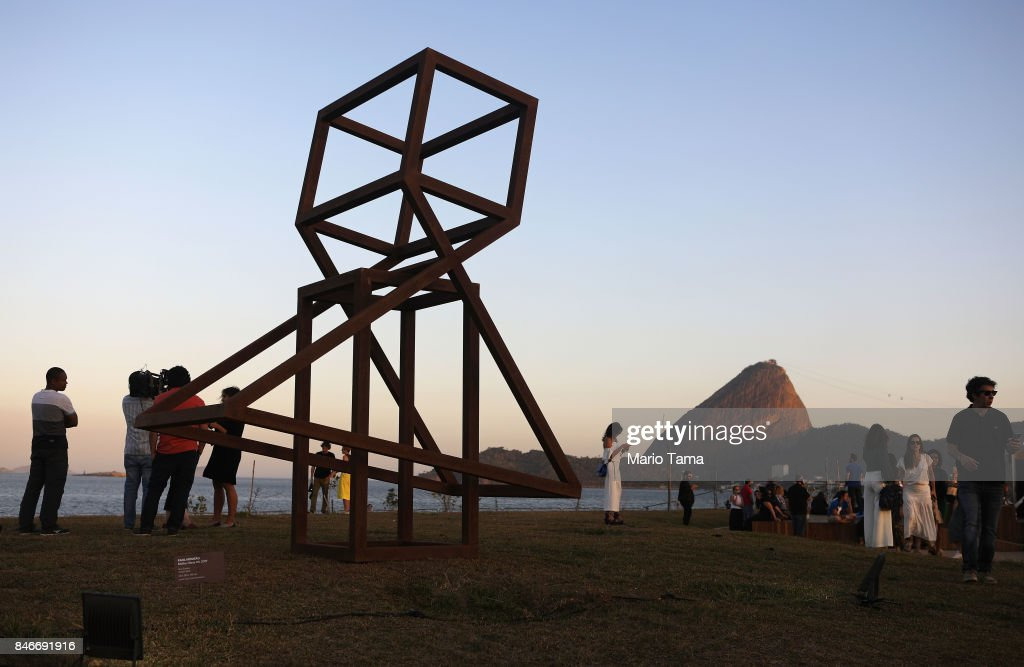 Visitors stand by a sculpture by artist Raul Mourao during a preview of the ArtRio 2017 international fair on September 13, 2017 in Rio de Janeiro, Brazil. 73 Brazilian and international artists will be on display at the Gloria Marina through September 17.