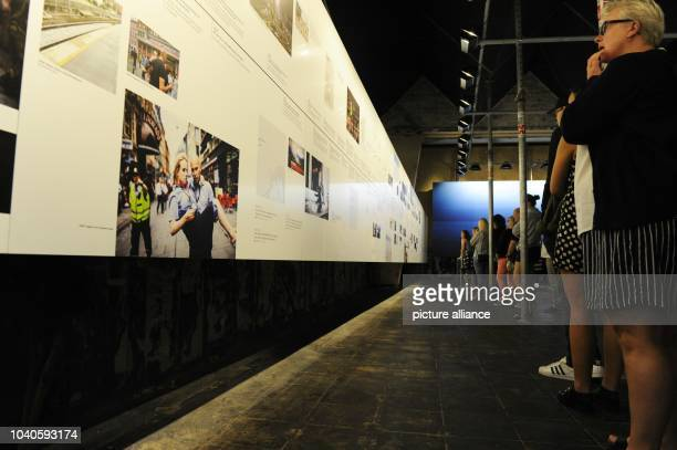 Visitors stand in front of a 17metre timeline of events of the 22 July 2011 in the '22 July Centre' in Oslo Norway 30 July 2015 A permanent...