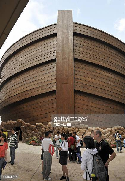 Visitors stand in front of the soontobeopened shopping mall called Noah's Ark at Park Island in the Tsing Yi district of Hong Kong on February 15...