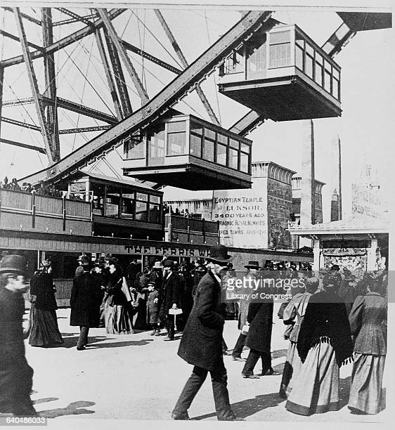 Visitors stand in line for a ride on the Ferris Wheel at the World's Columbian Exposition in 1893 Chicago Illinois USA