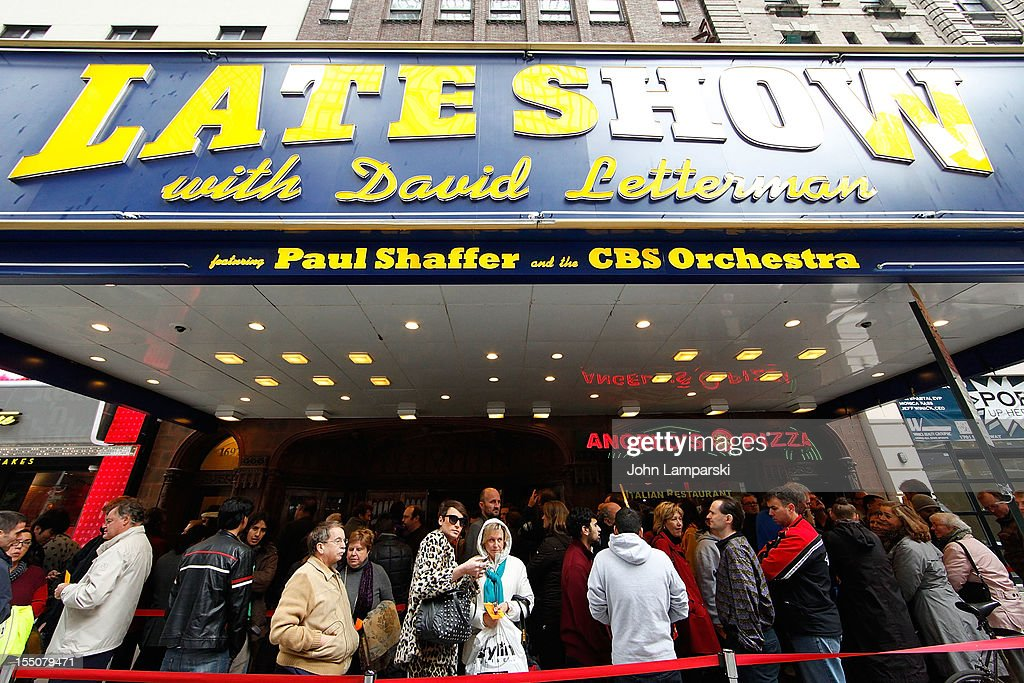 Visitors stand in line for the Late Show with David Letterman in Times Square following Hurricane Sandy on October 31, 2012 in New York City.