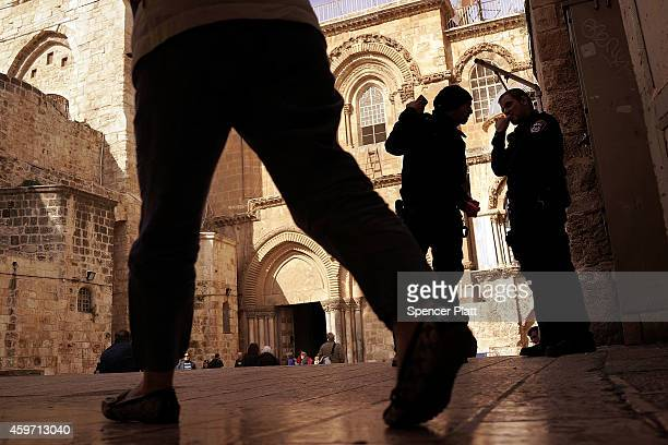 Visitors stand in the courtyard of the Church of the Holy Sepulchre on November 29, 2014 in Jerusalem, Israel. The church is said to be where Jesus...