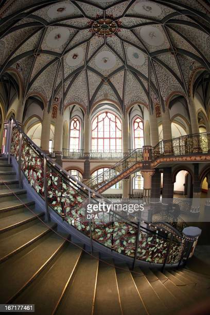 Visitors stand in the staircase of the restored former Prussian justice palace that serves now as county court in Halle an der Saale eastern Germany...
