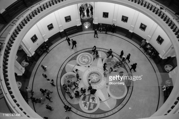 Image has been shot in black and white. Color version not available.) Visitors stand in the Texas State Capitol in Austin, Texas, U.S., on Wednesday,...