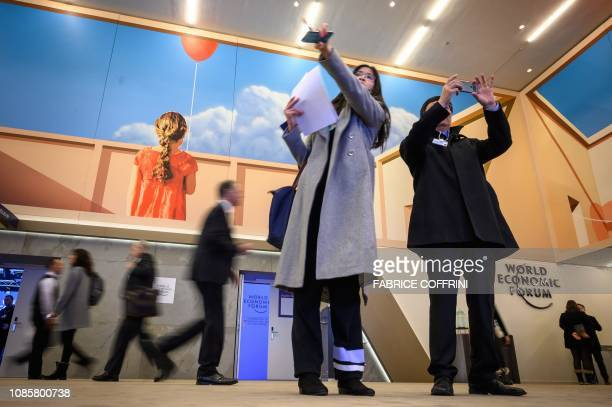 Visitors stand inside the Congress Centre ahead of the World Economic Forum annual meeting on January 21 2019 in Davos eastern Switzerland