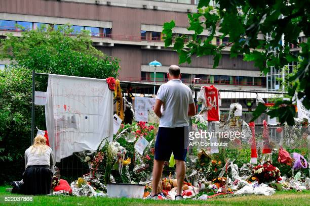 Visitors stand next to items placed by the hospital where the Ajax midfielder Abdelhak Nouri receives treatments in Amsterdam on July 22 2017 Ajax...