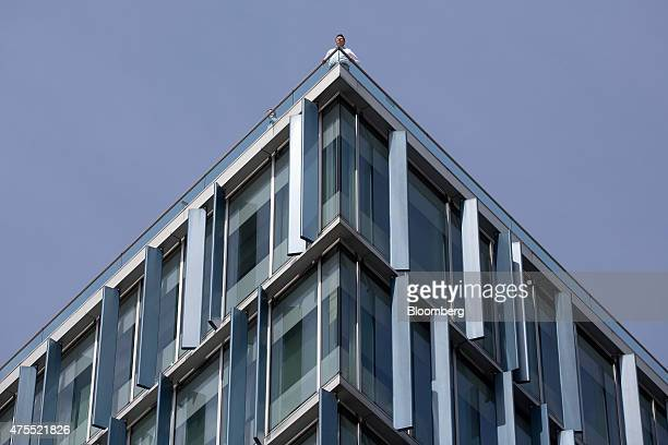 Visitors stand on the roof terrance of the Blue Fin building owned by Time Inc on Southwark Street in London UK on Monday June 1 2015 Time Inc the...