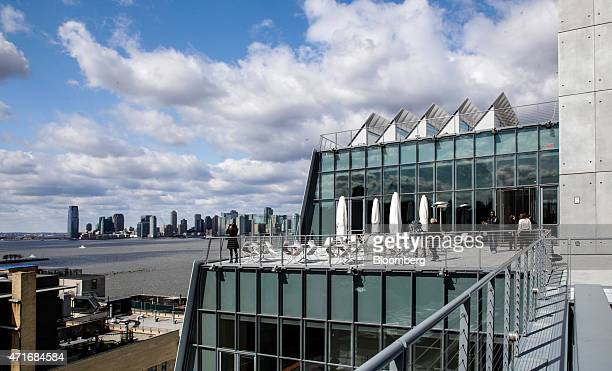 Visitors stand on the rooftop patio during a preview for media and guests at the new Whitney Museum of American Art in New York US on Thursday April...
