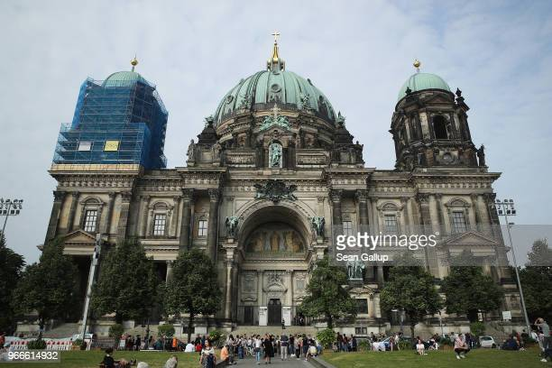 Visitors stand outside Berliner Dom cathedral following an incident on June 3, 2018 in Berlin, Germany. According to police a man wielding a knife...