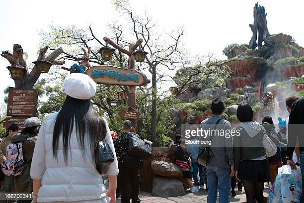 Visitors stand outside the Splash Mountain attraction at Tokyo Disneyland operated by Oriental Land Co in Urayasu City Chiba Prefecture Japan on...