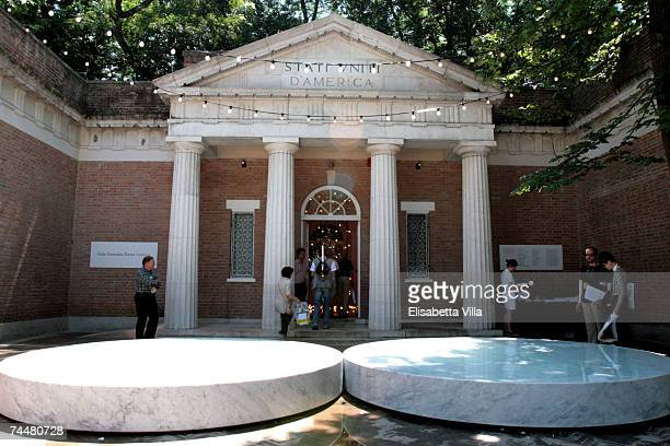 Visitors stand past the US pavilion entrance during the Biennale 52nd International Art Exhibition at Giardini June 9 2007 in Venice Italy