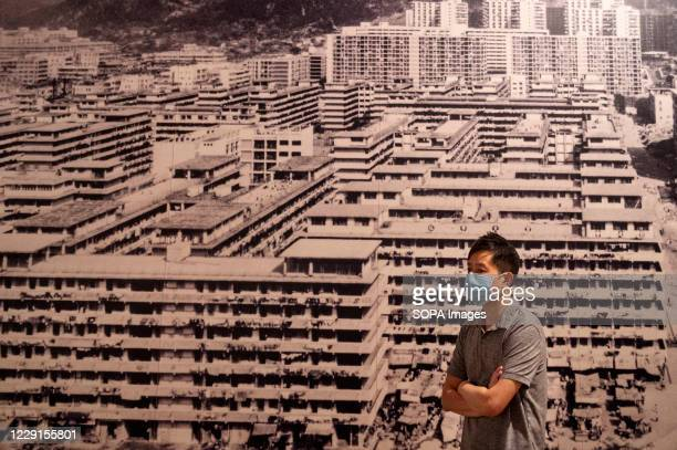 Visitors stands in front a old image of public state housing buildings at the Hong Kong museum of History. The permanent exhibition of the museum...