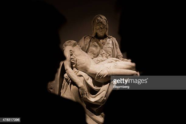 Visitors stands in front of the La Pieta sculpture by Michelangelo Buonarroti on display at the Palacio de Bellas Artes in Mexico City Mexico on...