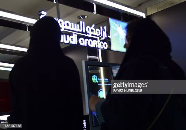 Visitors stop at the Aramco exhibition section at the Misk Global Forum on innovation and technology held in the Saudi capital Riyadh on November 13...
