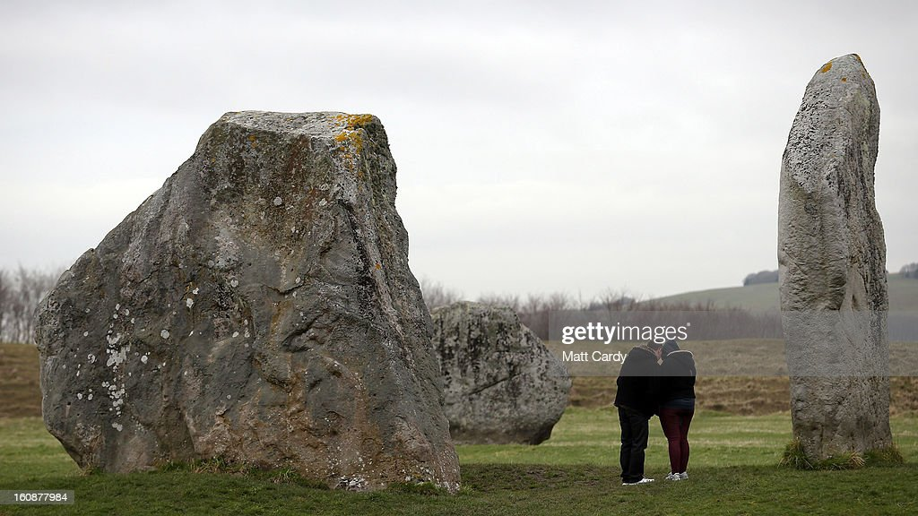 Visitors stop besides the Neolithic stones at Avebury on February 7, 2013 in Wiltshire, England. A leading travel magazine has recently named the collection of stones - thought to have been constructed around 2600BC and the largest stone circles in Europe, as the second best heritage site in the world. The Wiltshire world heritage site has been placed ahead of much more recognisable sites including the Valley of the Kings in Egypt, Taj Mahal in India and the Forbidden City in China.