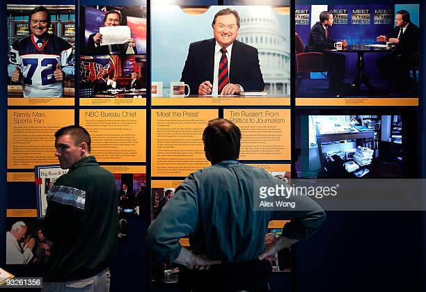 Visitors stop by the Inside Tim Russert's Office If It's Sunday It's Meet the Press exhibition at the Newseum November 20 2009 in Washington DC The...