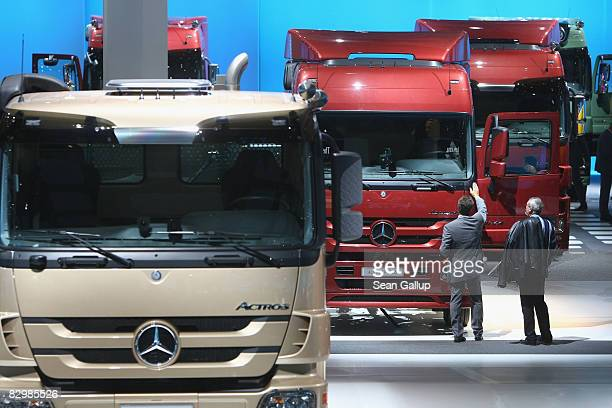 Visitors stop to examine MercedesBenz heavy trucks at the Daimler stand during a media and industry professionals' day at the IAA Commercial Vehicles...