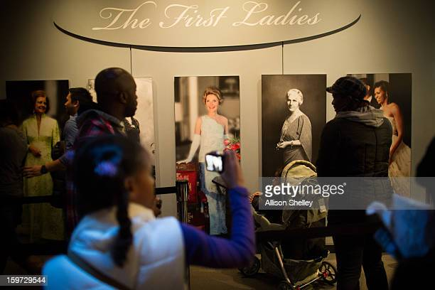 Visitors stream into an exhibition entitled The First Ladies at the National Museum of American History January 19 2013 in Washington DC The US...