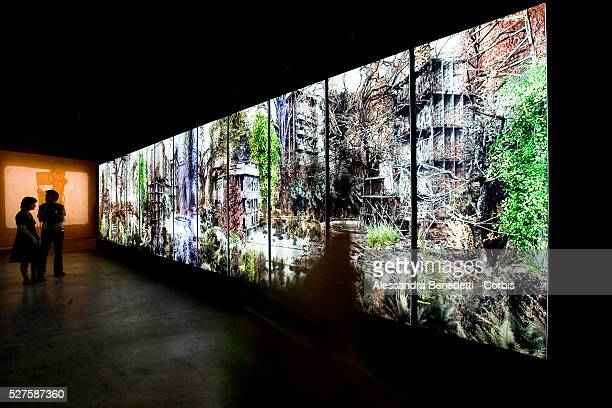 Visitors stroll at the Italian pavillion during the vernissage of the 53rd Biennale Internazional Art Exhibition in Venice