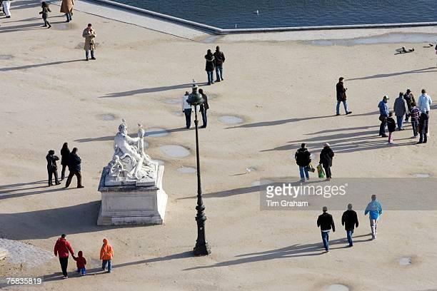 Visitors stroll through Jardin des Tuileries Central Paris France
