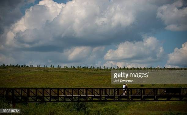Visitors stroll through the Flight 93 National Memorial in Shanksville Pennsylvania on August 19 2016 American Airlines Flight 93 crashed into a...