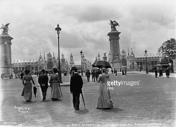 Visitors strolling towards the Pont Alexandre III during the Exposition Universelle Paris 1900 The bridge was constructed for the event