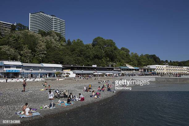 Visitors sunbathe on the beach beside the Black Sea in Sochi Russia on Monday May 2 2016 The ruble weakened the most among currencies worldwide...