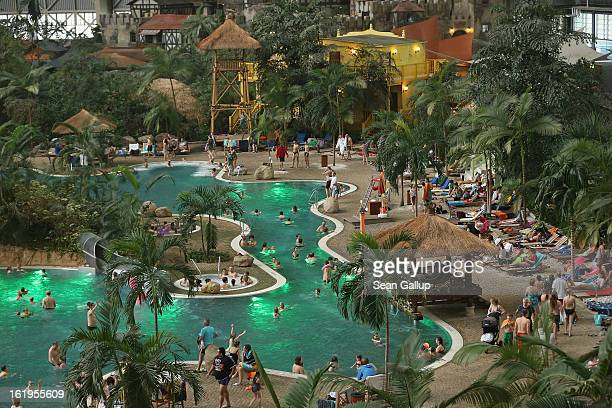 Visitors swim in the lagoon at the Tropical Islands indoor resort on February 15 2013 in Krausnick Germany Located on the site of a former Soviet...