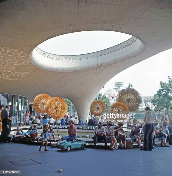 Visitors take a break under the overhang of the Kodak Pavilion during the World's Fair in Flushing Meadows Park in Queens New York New York June 1965