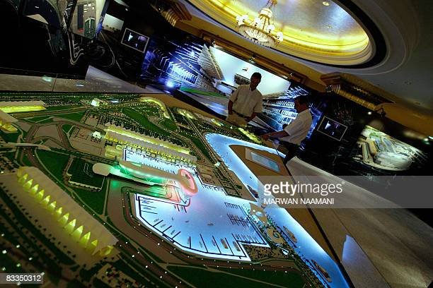 Visitors take a look at a model of the Formula 1 Yas Island circuit at an exhibition in Abu Dhabi on October 19, 2008. The circuit that is under...