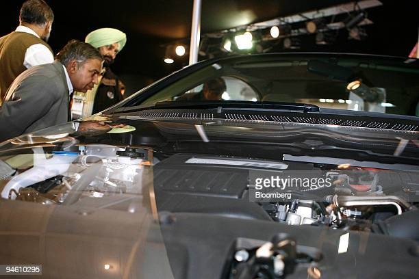Visitors take a look at Honda Motor Co Ltd's Civic Hybrid car at the Auto Expo 2008 in New Delhi India on Thursday Jan 10 2008 Almost seven...