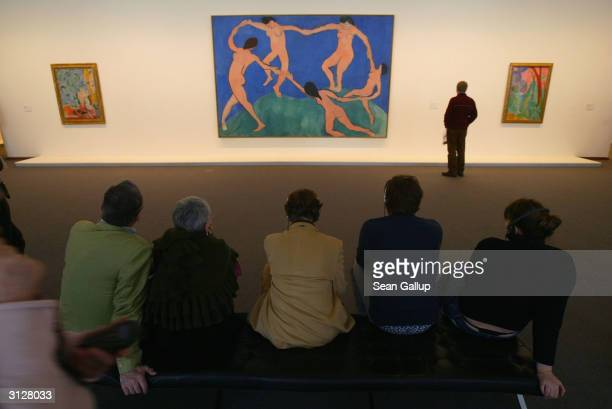 "Visitors take a look at paintings by Henri Matisse, including ""Dance"" at the MoMA exhibit, on March 24, 2004 in Berlin, Germany. The exhibit, which..."
