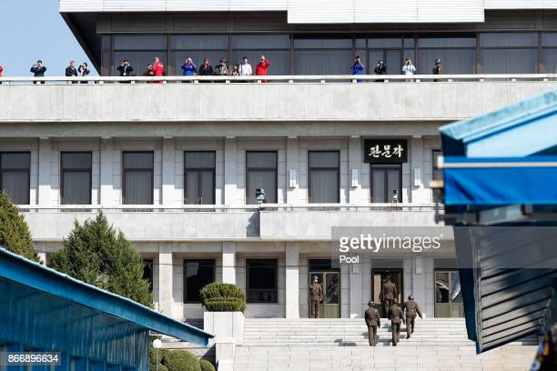 Visitors take a look from North Korean side while US Defense Secretary Jim Mattis and South Korean Defense Minister Song Youngmoo visit at the truce...
