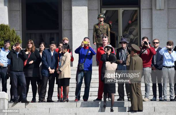 Visitors take a look from North Korean side while US Secretary of Defence Jim Mattis and South Korean Defence Minister Song YoungMoo visit at the...