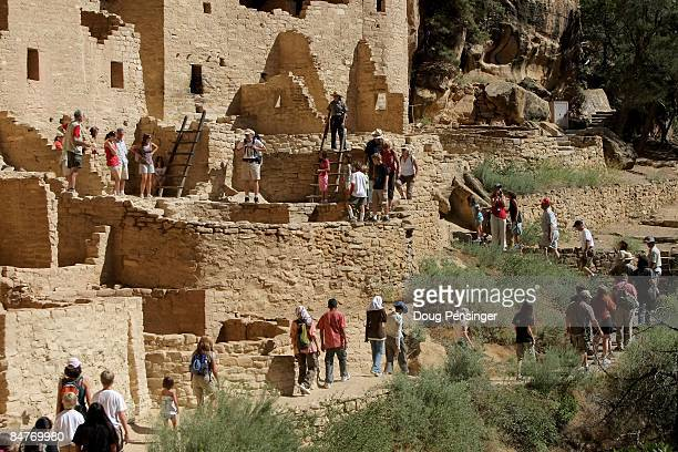 Visitors take a one hour ticketed ranger guided tour of Cliff Palace Mesa Verde�s largest cliff dwelling at Mesa Verde National Park on August 7 2008...