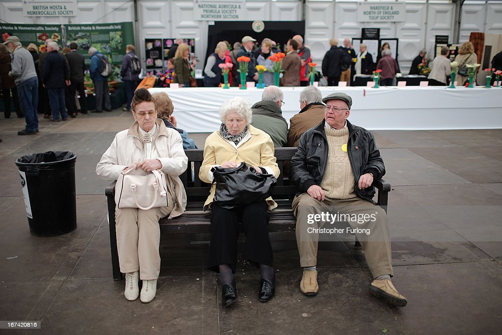Visitors take a rest break at the Harrogate Spring Flower Show on April 25, 2013 in Harrogate, England. Over 100 nurseries are staging displays of their flowers and plants at the Harrogate Spring Show organised by the north of England Horticultural Society. The premier gardening event of the north attracts thousands of horticulturalists to view it's show gardens and Spring floral displays.