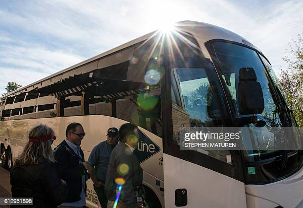 Visitors take a shuttle bus to Paisley Park in Chanhassen Minnesota on October 6 2016 Paisley Park the late pop star Prince's closelyguarded studio...